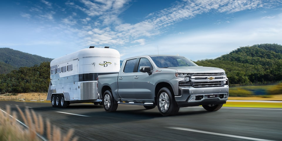 Chevy Homepage: <Silverado front 3/4 towing>